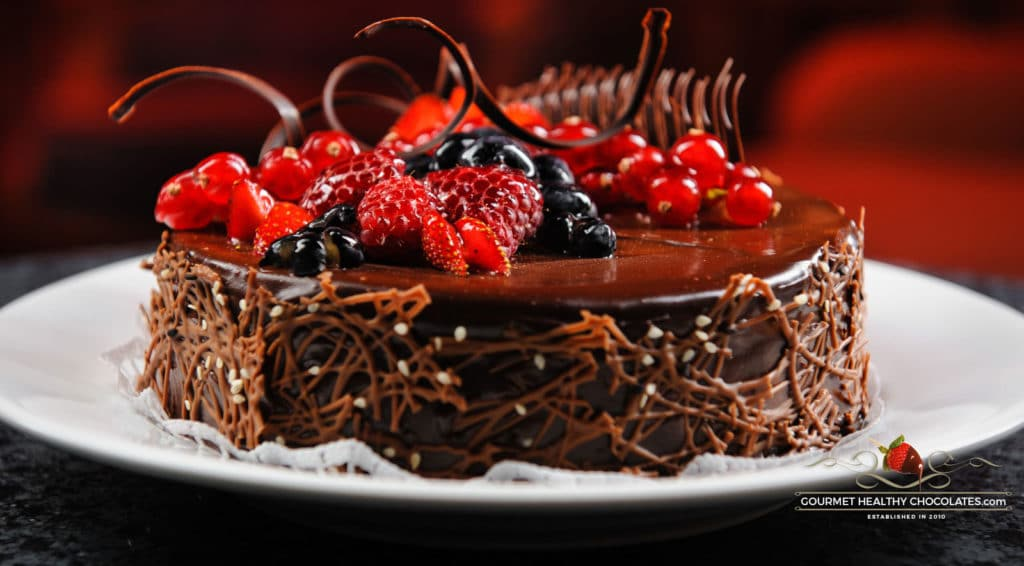 gourmet-cake-with-field-berries-and-shaved-chocolate-fondant-icing